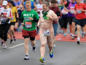 LONDON, UNITED KINGDOM - APRIL 26:  A runner dressed in a naked suit in the mass start during the Virgin Money London Marathon on April 26, 2015 in London, England. (Photo by Stephen Pond/Getty Images)