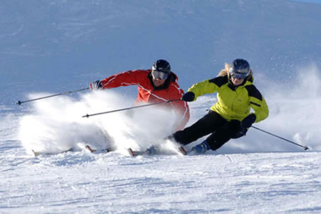 man and women skiing