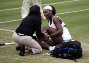 Tennis - Wimbledon - All England Lawn Tennis & Croquet Club, Wimbledon, England - 2/7/07 Serena Williams of the USA receives treatment to her calf as she suffers from cramp but plays on in the fourth round Mandatory Credit: Action Images / Reuters / Eddie Keogh Picture Supplied by Action Images *** Local Caption *** EK260_EK3022__Q2W0017.jpg