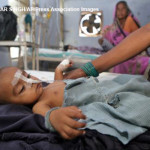 A child suspected to be suffering from Dengue fever, caused by the aedes mosquitoes, receives treatment at the Childrens Hospital in Allahabad, India, Wednesday, Aug. 29, 2007. Health officials had warned of the risks of skin infections, malaria, leptospirosis and dengue fever after flood water caused by monsoon rains receded. (AP Photo/Rajesh Kumar Singh)