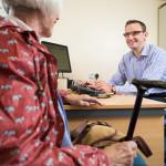 MODEL RELEASED. General practice (GP) doctor seeing an elderly female patient.