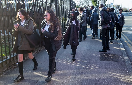 Pupils of a secondary school going home after school