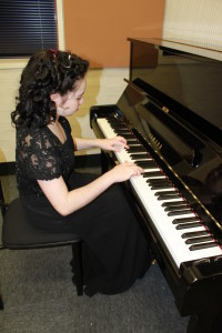 Miss Imogen Scott-Parker preparing for a concert