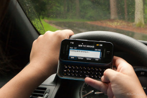 Texting while driving is ... (f/13, 1/50 sec, 48mm)