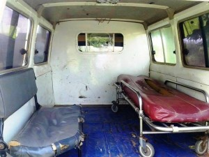 The interior of the ambulance, lacking paramedic supplies for first aid.