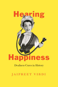 Yellow cover, red words, black and white image of a woman with a hearing device