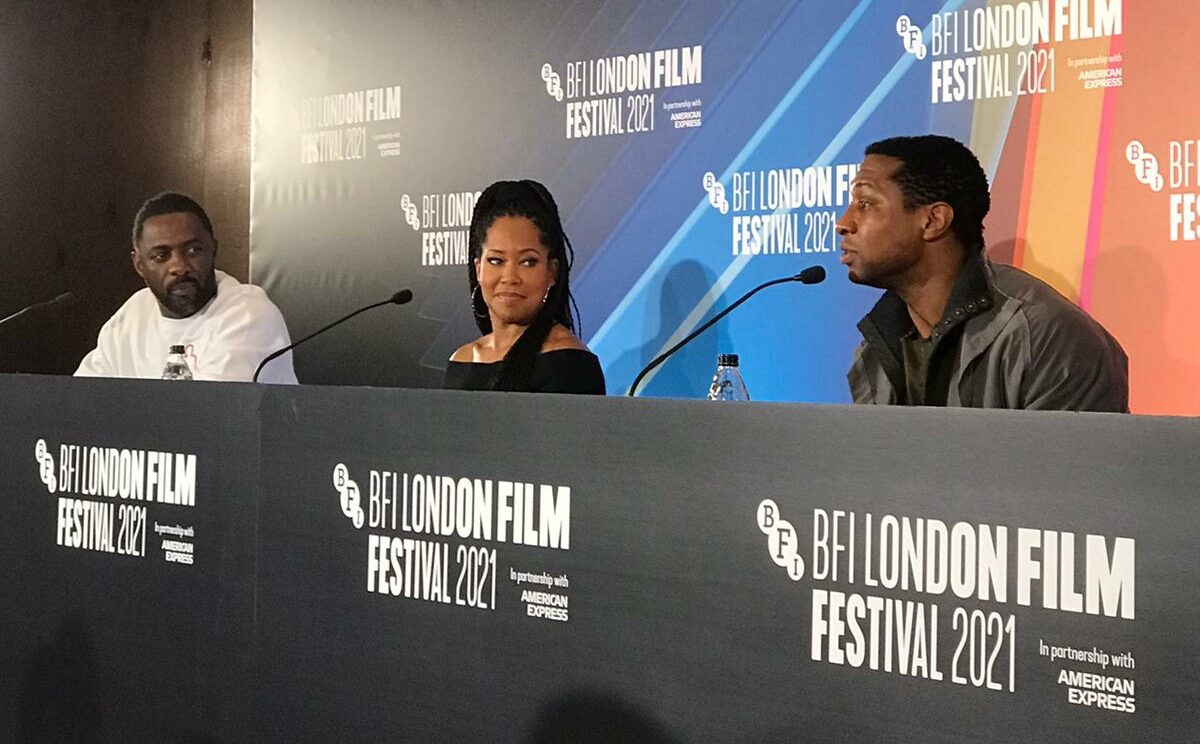 Idris Elba, Regina King, and Jonathan Majors reflecting on their roles in 'The Harder They Fall'.